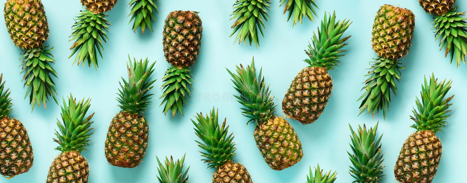 Bright pineapple pattern for minimal style. Top View. Pop art design, creative concept. Copy Space. Banner. Fresh stock photos