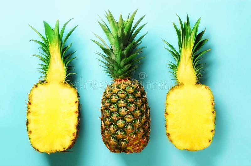 Bright pineapple pattern for minimal style. Top View. Pop art design, creative concept. Copy Space. Fresh pineapples on. Blue background stock image
