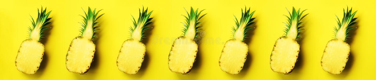 Bright pineapple pattern for minimal style. Top View. Pop art design, creative concept. Copy Space. Fresh pineapples on royalty free stock image