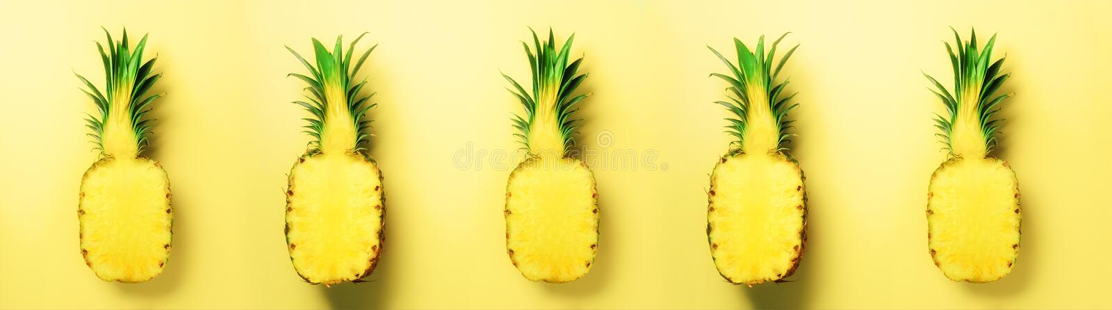 Bright pineapple pattern for minimal style. Top View. Pop art design, creative concept. Copy Space. Fresh pineapples on stock photos