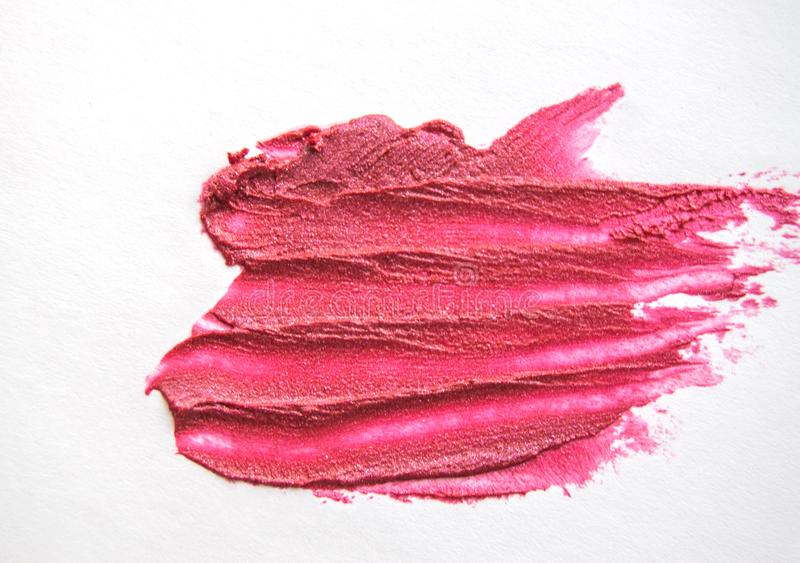 Bright pink brush strokes and the texture of the lipstick or lip gloss isolated on white background, concept of makeup and beauty. Paint, glitter, acrylic royalty free stock photos