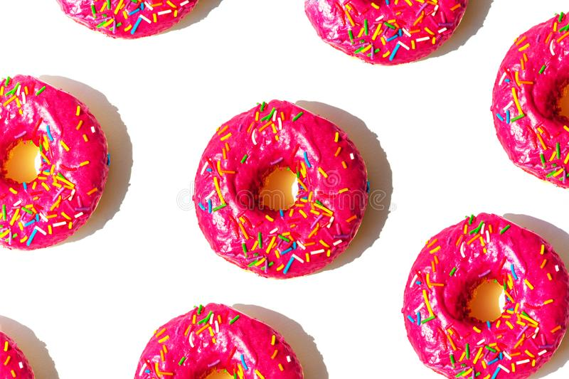 Bright pink donuts on a white isolated background.  stock photos