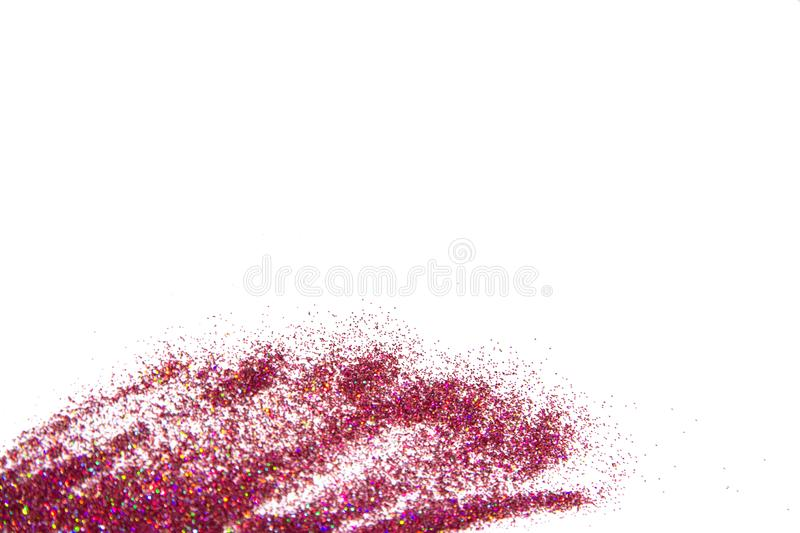 Bright pink glitter isolated on white background with  copy space. Bright pink glitter isolated on white background. border frame, copy space stock photo