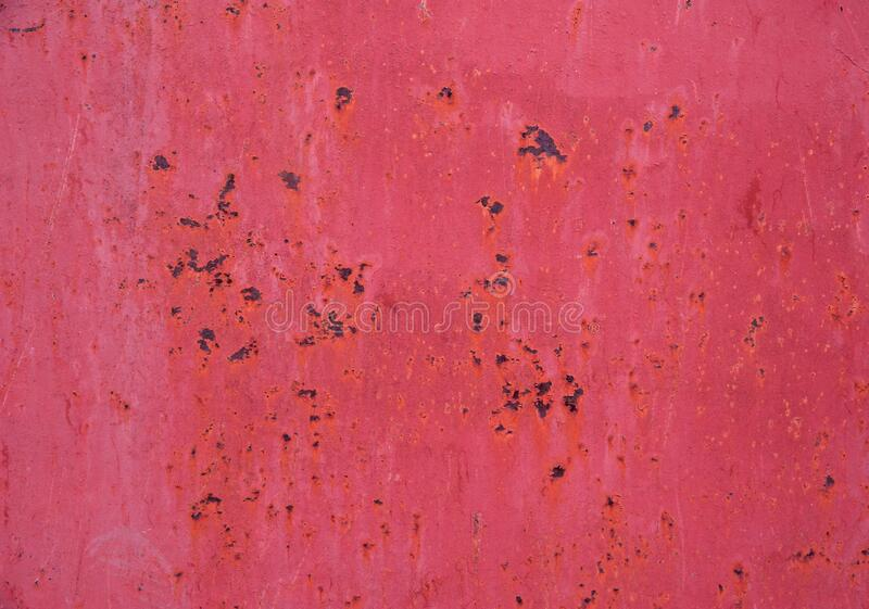 Bright pink metal surface with scratches and rust spots. Abstract background, texture stock photography