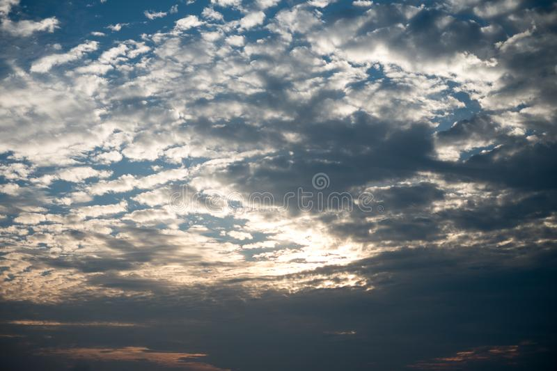 A bright pink and orange sunset sky obscured by clouds.  stock images