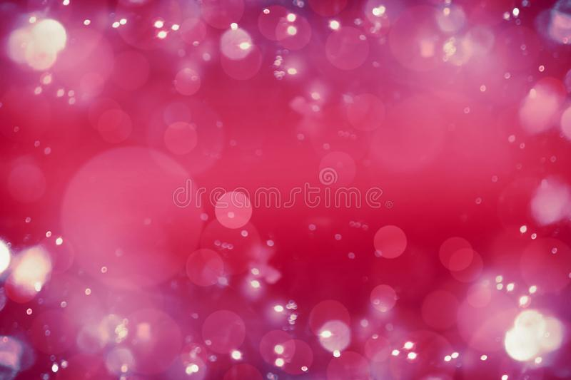 Bright pink red bokeh background. Blurred abstract holiday or event background royalty free stock photo
