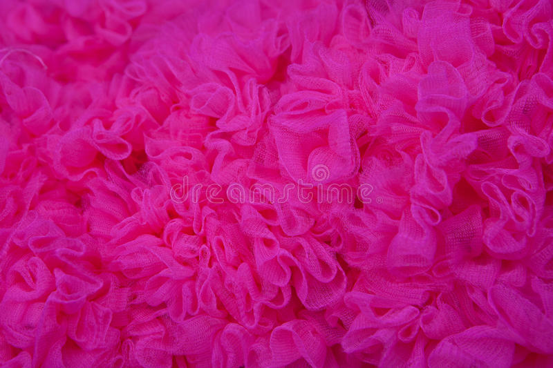 Bright pink texture background. Bright pink texture net fabric background royalty free stock photo