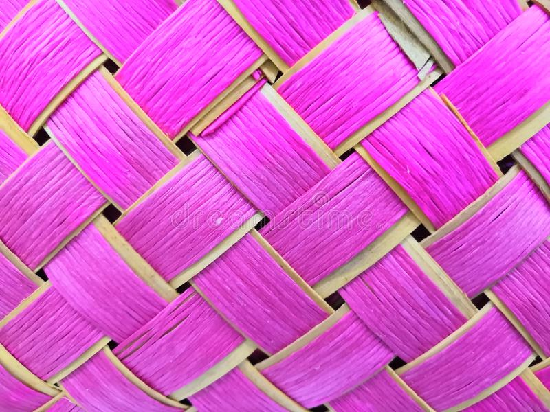 Bright pink texture squares in a wicker basket background royalty free stock photos