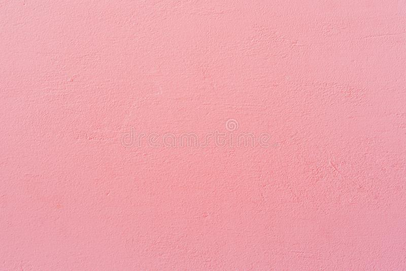 Bright pink wall texture background. Close-up image of bright pink wall texture background royalty free stock photo