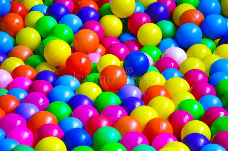 Bright plastic balls on the children`s playground royalty free stock photography