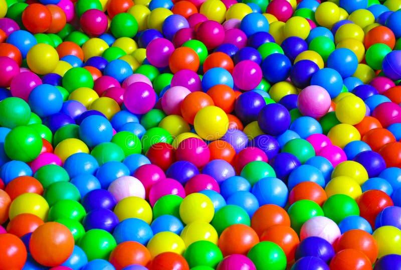 Bright plastic balls on the children`s playground royalty free stock photo