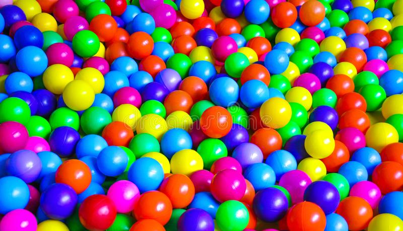 Bright plastic balls on the children`s playground stock photos