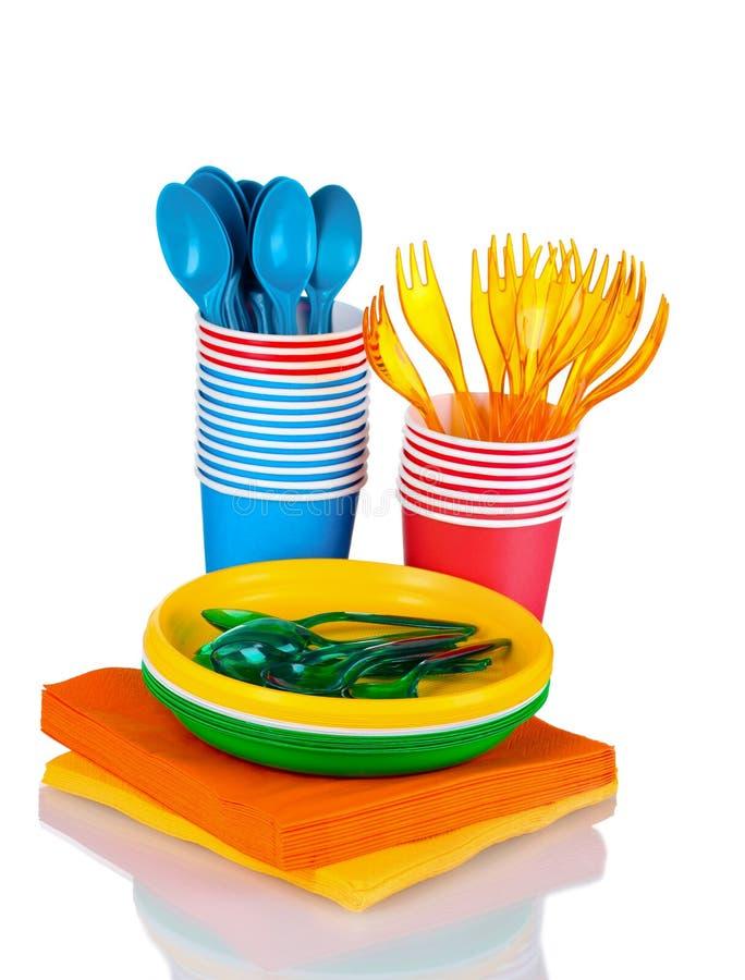 Bright plastic tableware and napkins stock photos