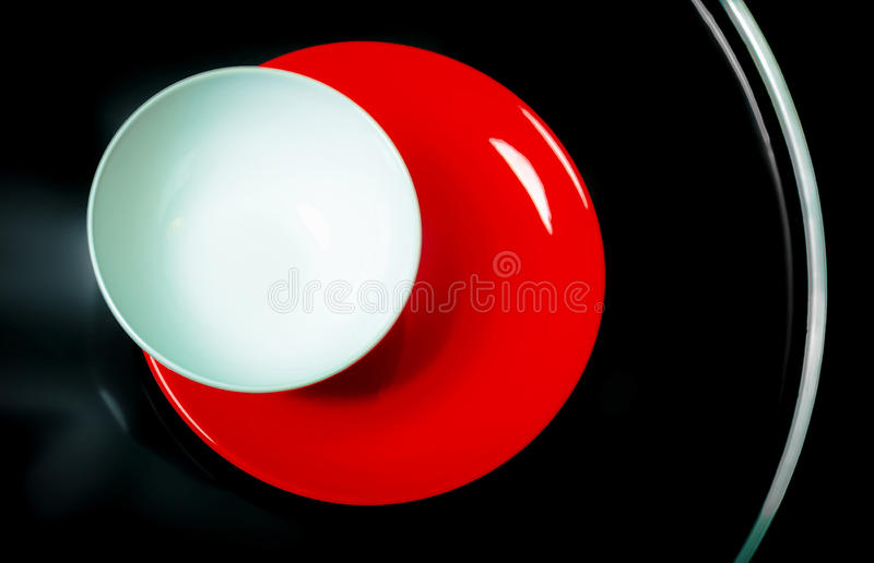 Bright plates on a black table royalty free stock image