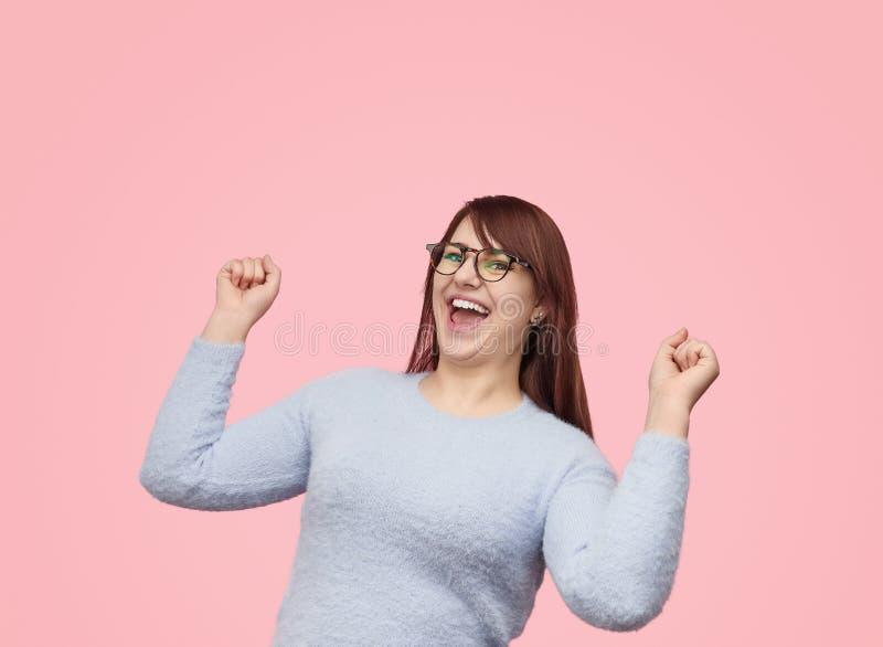 Bright plump girl celebrating success royalty free stock photos