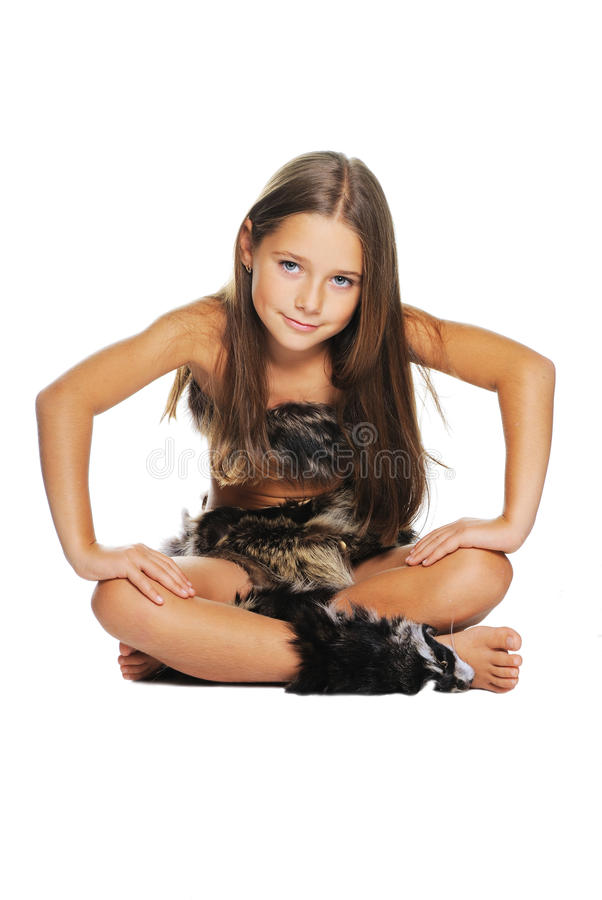 Bright portrait of little girl dressed in furs. On white background royalty free stock photo