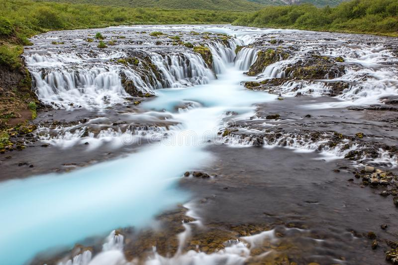 Bright powerful Bruarfoss waterfall in Iceland with cyan water. stock images
