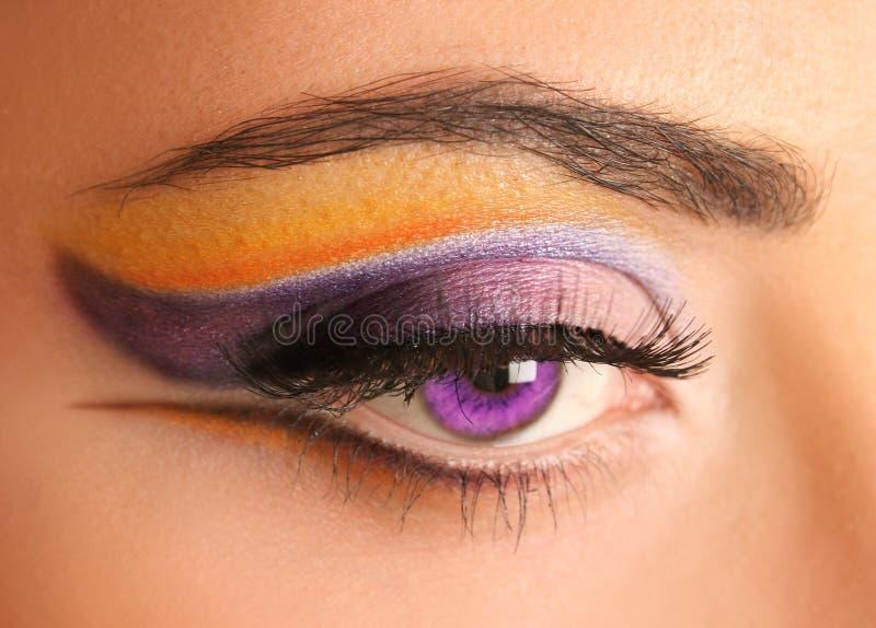 Bright purple eye. Woman eye with bright beautiful make-up stock image