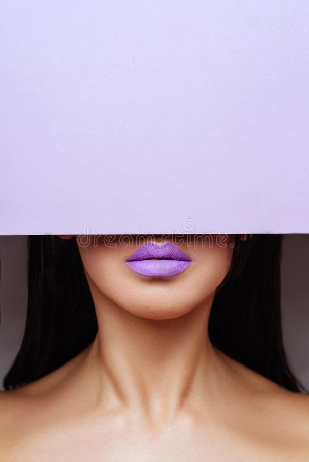 Free Bright Purple Lips Looks Into The Hole Of The Colored Paper. Stock Photos - 145454523