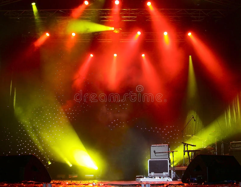Bright rays of light on stage stock photos