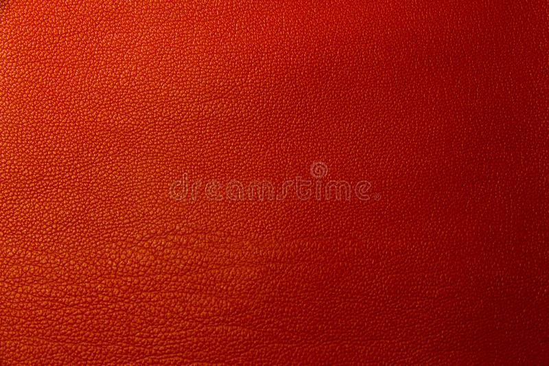 Red leather textural background. Bright red background with skin texture closeup royalty free stock photos