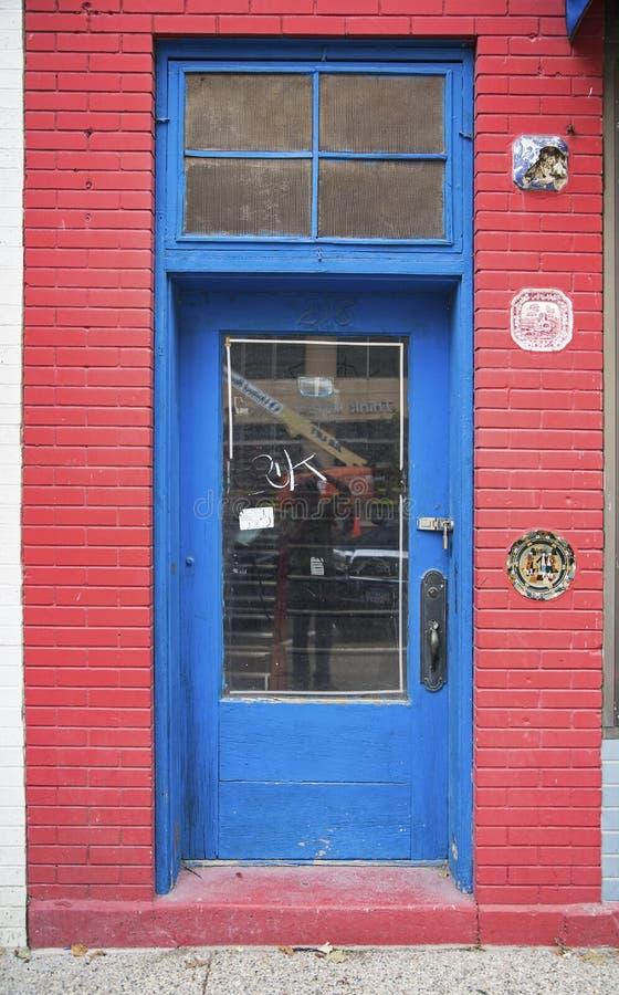 Red Painted Doorway Rotten Metal Hinges Stock Photo
