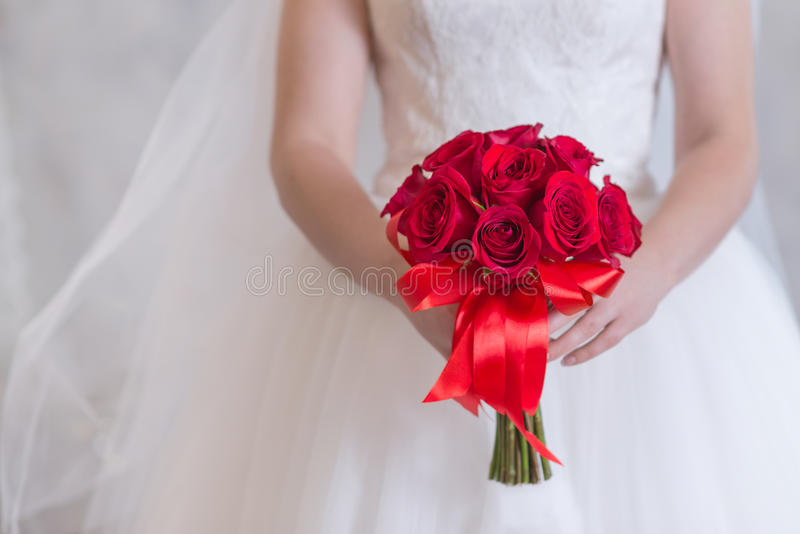 Bright Red Bouquet Of Roses In Hands Of The Bride, Close Up. Stock ...