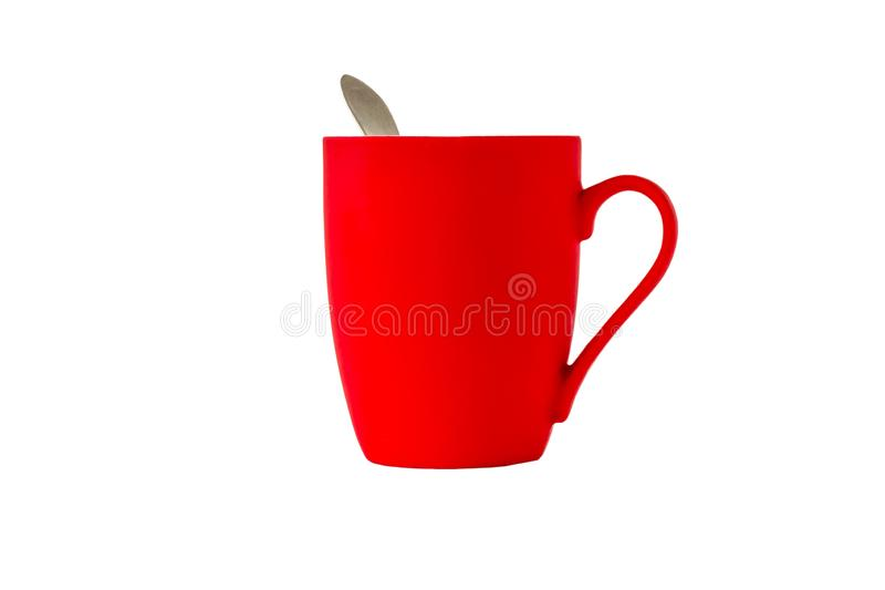 Bright red ceramic mug with handle and with a spoon isolated on white background stock photography