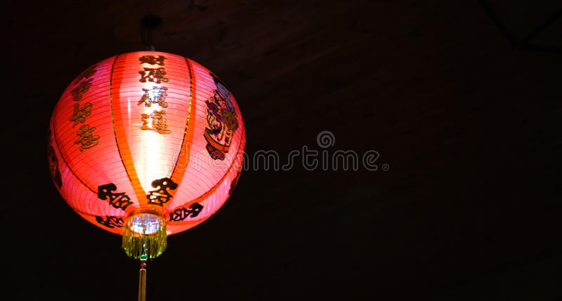 Bright red chinese lantern at night, with black background royalty free stock photos