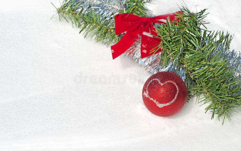 Bright Red Christmas Ball Ornament In Snow Stock Photography