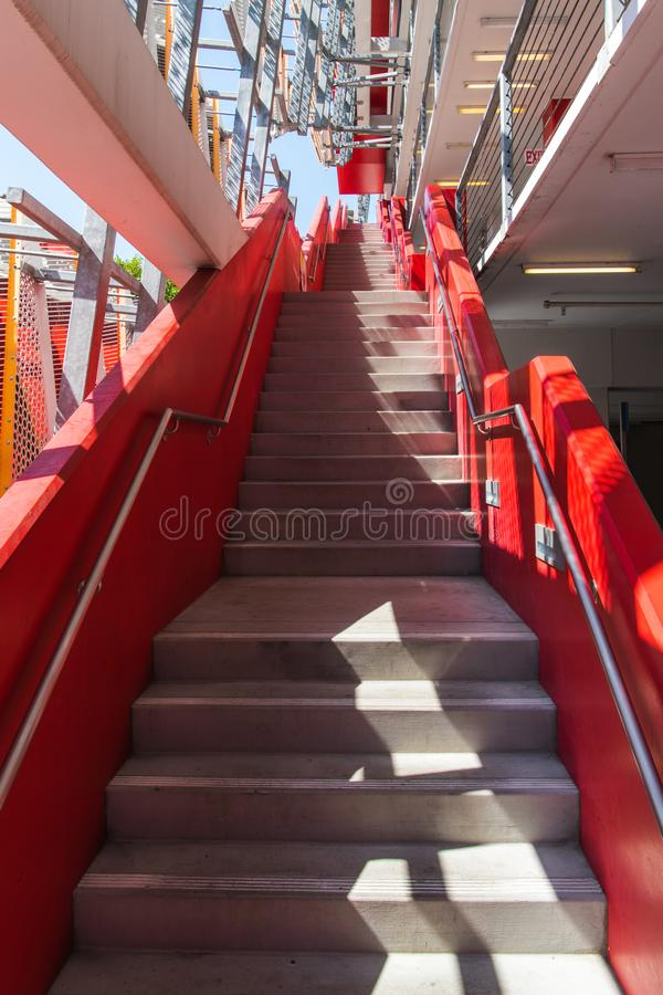 Bright red concrete stairway on the exterior of a modern building royalty free stock photo