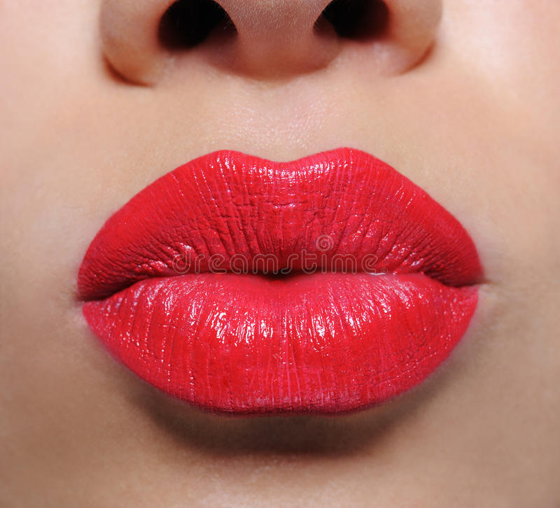Bright red female lips stock photos