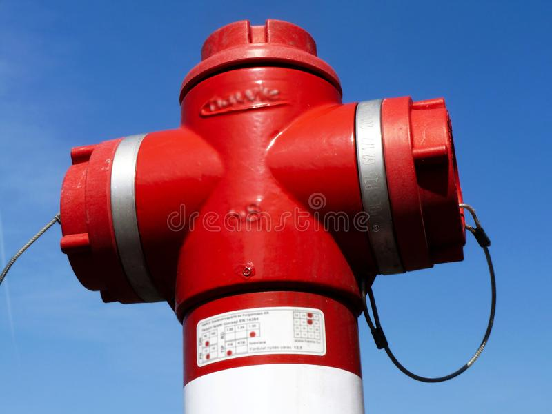 Red fire hydrant close-up under blue sky. abstract view royalty free stock images