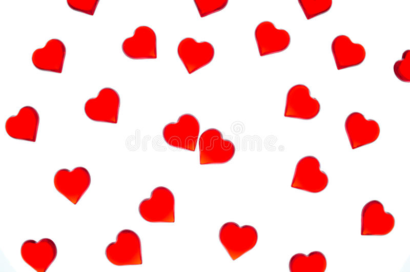 Bright red hearts on a striped background. In order to use Valentine`s Day, weddings, International Women`s Day. Red hearts on a striped background. In order to royalty free stock image