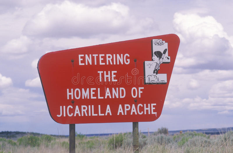 Bright red sign Entering the Homeland of Jicarilla Apache in NM stock images