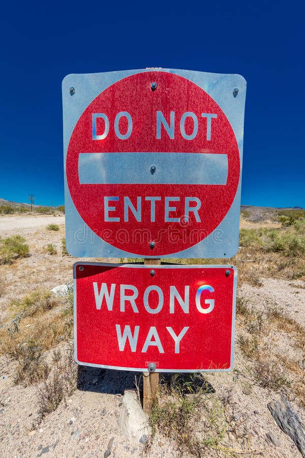 Bright Red sign warns drivers not to enter this lane of highway, Interstate 15, in desert outside of Las Vegas - WARNING - WRONG W. AY!, Nevada royalty free stock photo