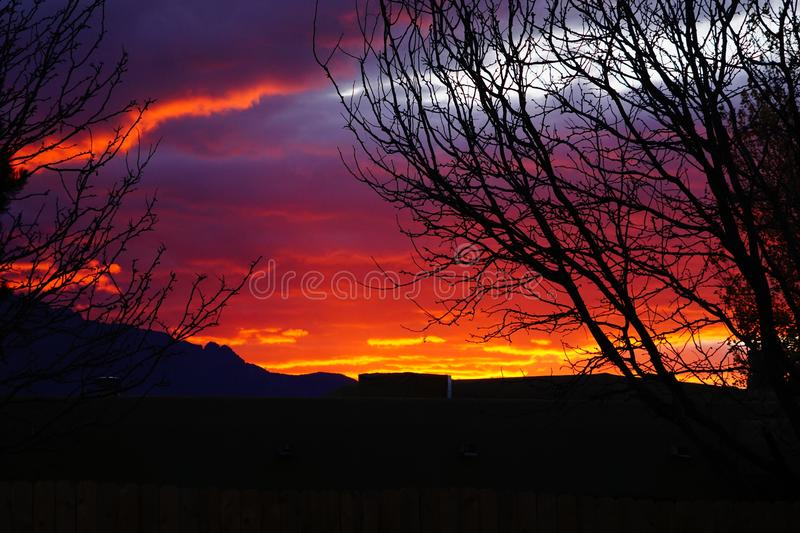 A bright red sunrise in New Mexico. A picture of a bright red sunrise behind the Sandia mountains of New Mexico stock images