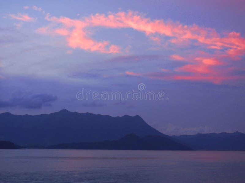 Bright Red Sunset Glow on Seashore stock photo