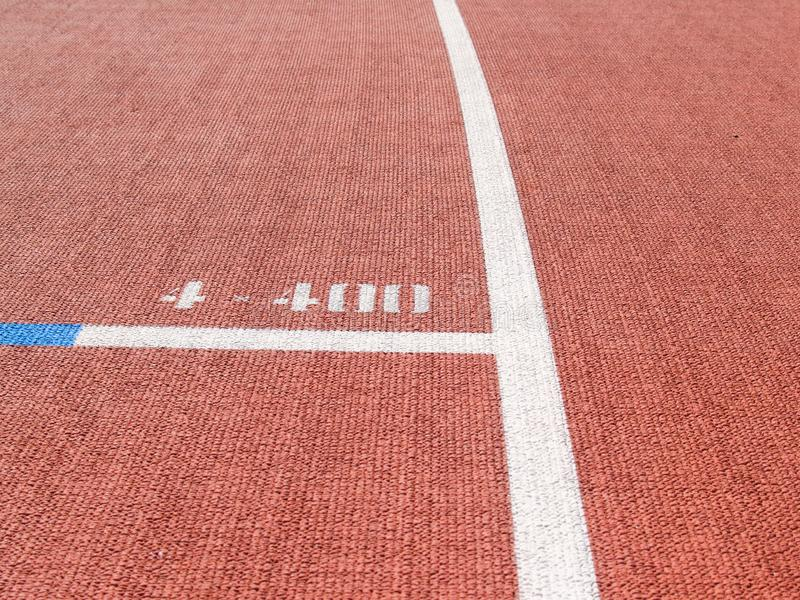 Bright red synthetic running track. With white line and number 400 royalty free stock images