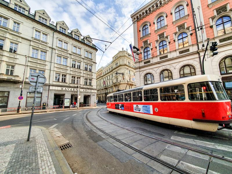 The bright red tram in Prague carries customers around the city on a bright sunny day in April royalty free stock photos