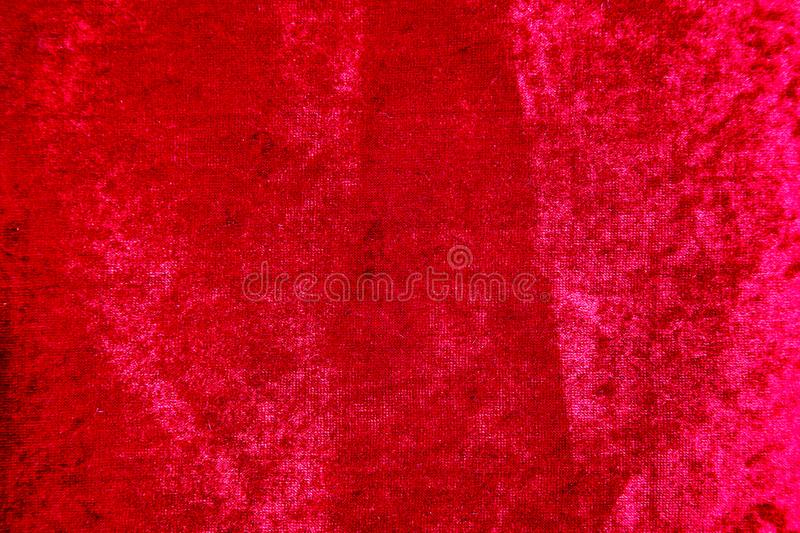 Bright red velvet fabric canvas for upholstery furniture stock photo