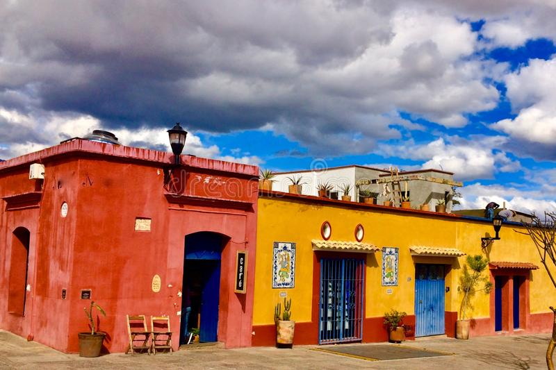 Colorful colonial houses. Oaxaca, Mexico. Bright red and yellow colored colonial houses in artsy mexican neighborhood, Oaxacan royalty free stock photography