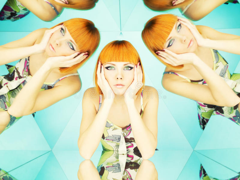 Bright redhead woman in kaleidoscope royalty free stock photography