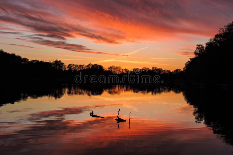 Bright reflected sunset on a lake royalty free stock images