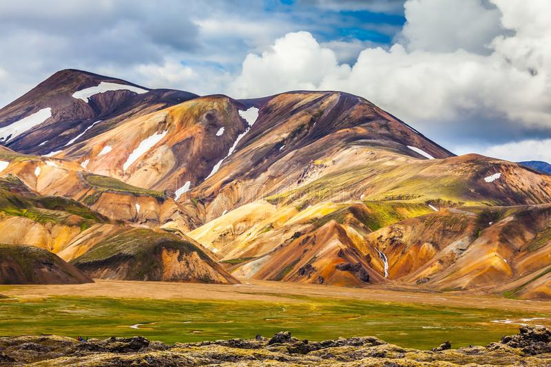 Bright rhyolite mountains. Summer volcanic tundra.  Bright, multi-colored rhyolite mountains - yellow, orange, green and blue. Travel to Iceland in July stock photo