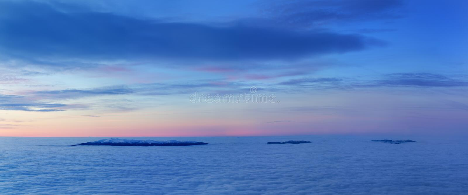 Bright saturated colors dawn above the sea of fog over the tops of the Carpathian is fabulously beautiful panoramic view. Bright saturated colors dawn above the royalty free stock photos