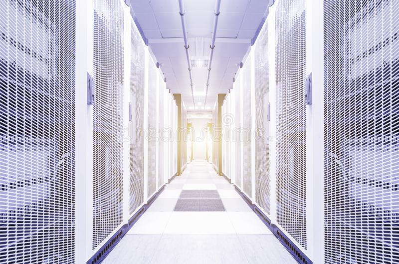Bright server room data center storage interior. Network placement with computers for digital communications and internet. Rows of hardware equipment stock images