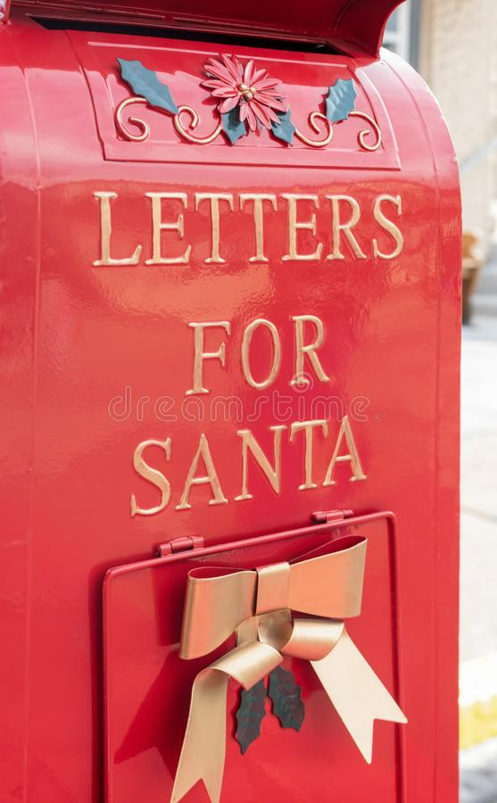Bright shiny red mailbox for children to mail letters to Santa Claus stock image