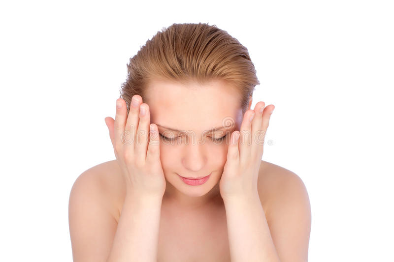 Bright shot of young woman with hand near her face stock images