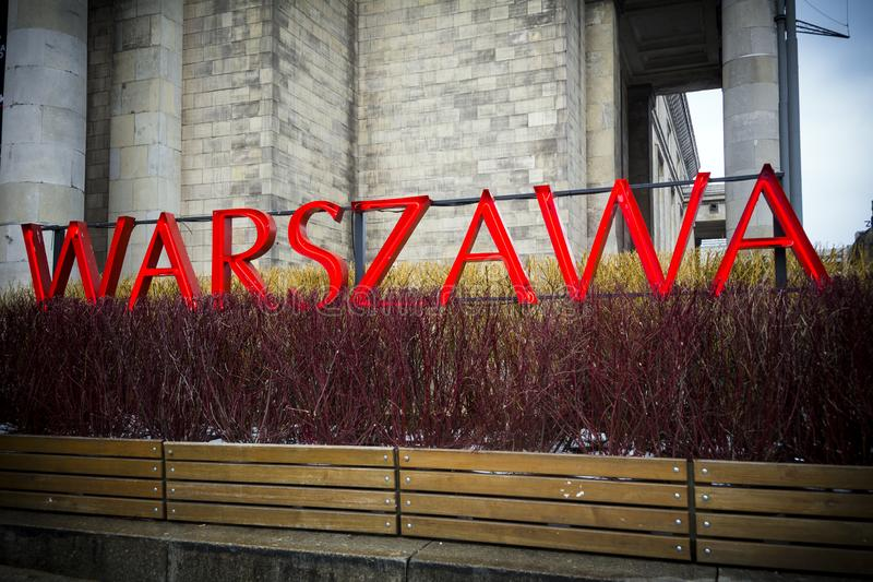 Warsaw neon sign in the centre of the Polish capital. Bright sign in Polish of the capital city stock photography